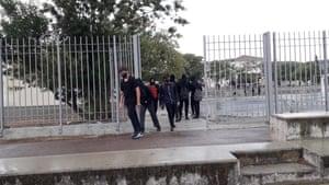 Pupils in Nicosia school exit premises wearing masks.